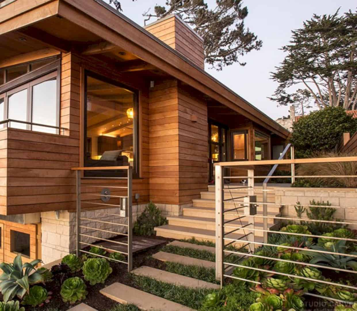 Wilder butterfly a modern wooden home with a vertical for Golden rule garage door