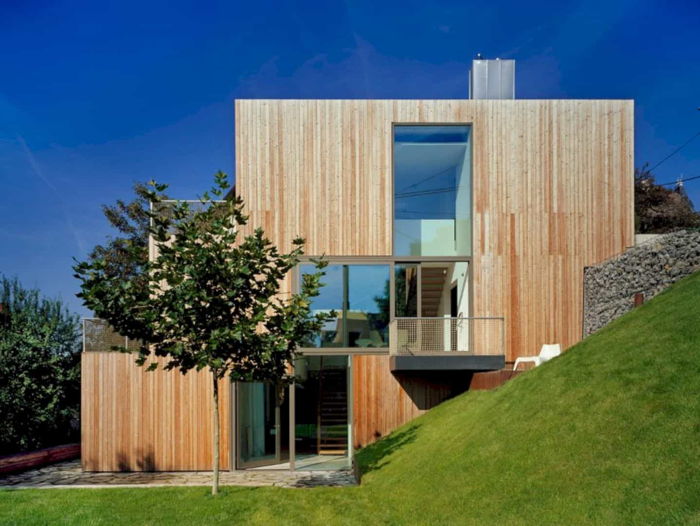 Haus am Hang: A Traditional, New Family Home that Tucked into the ...