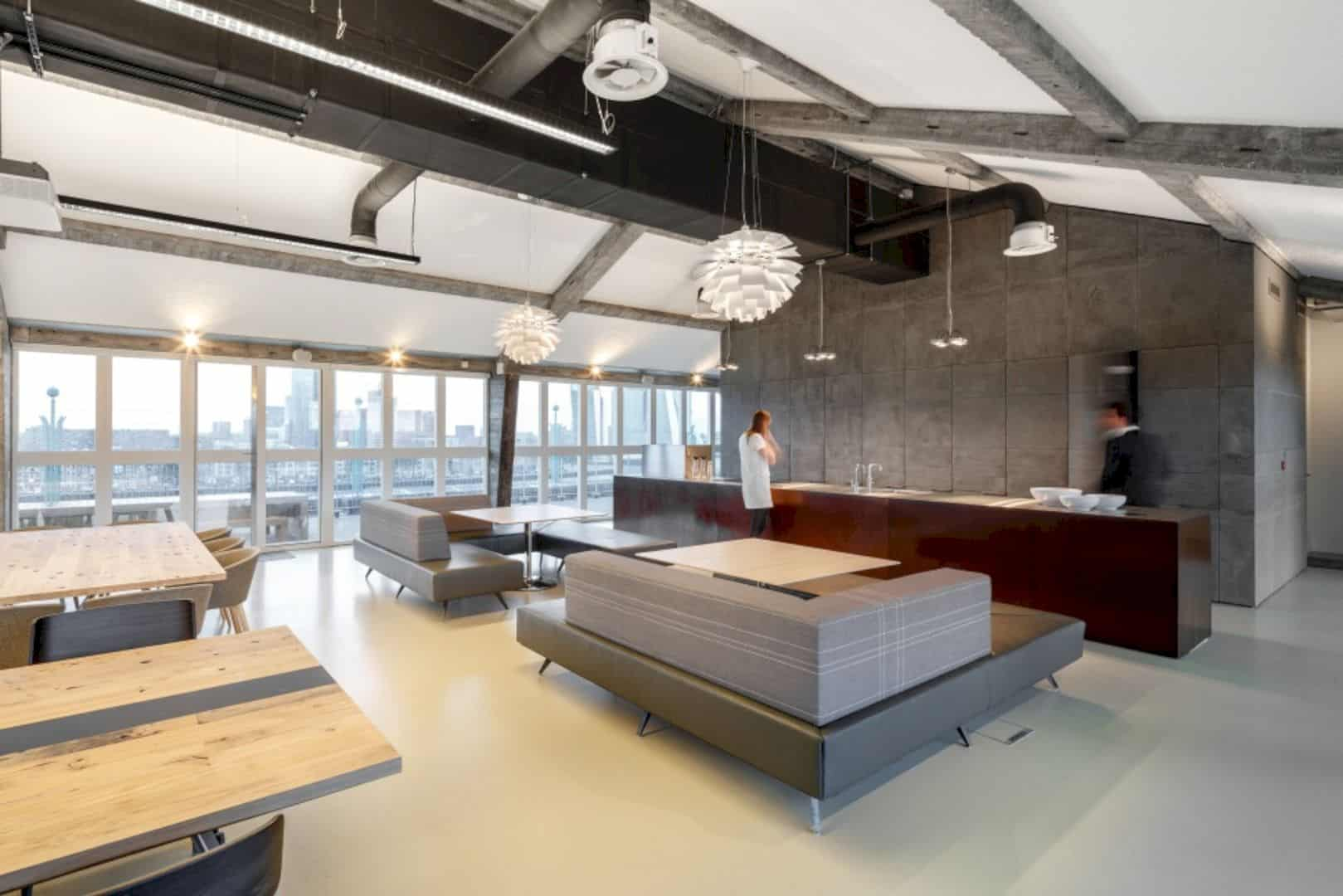 OC&C Strategy Consultants: A Comfortable, Industrial New Office with Spectacular Views