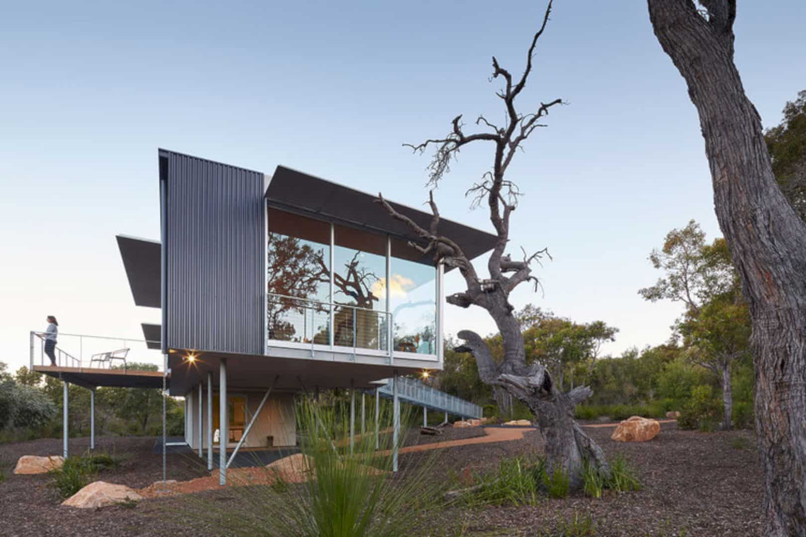 Wilderness House: A Modern House with Large Area of Glass and Modernist Elevated Platform